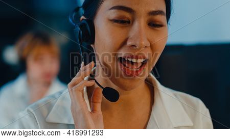Closeup Of Asia Young Call Center Team Or Customer Support Service Executive Using Computer And Micr