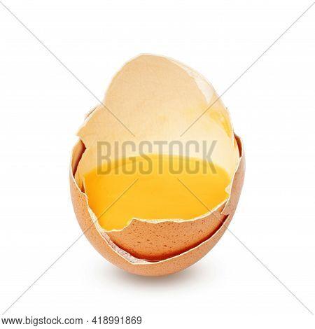 Broken Egg In Half Eggshell Isolated On White Background.