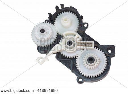 Cogwheels Mechanism In Black Plastic Case. Inkjet Printer Part: Complex Mechanical Drive Made Of Mul