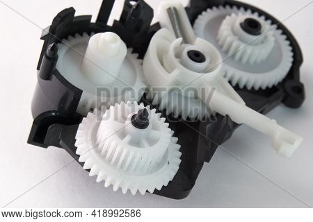 White Plastic Spur Gears Connected In Complex Mechanism, Part Of The Inkjet Printer Paper Feeder Mec