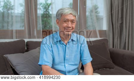 Portrait Asian Chinese Senior Man Feeling Happy Smiling At Home. Older Male Relax Toothy Smile Looki