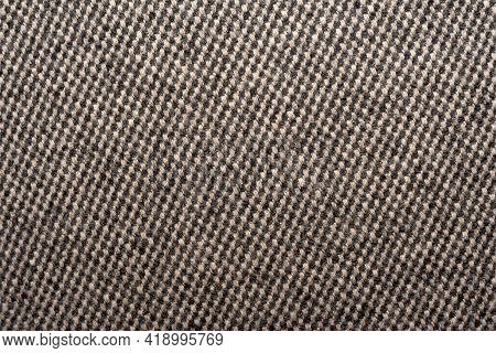 Fabric. The Fabric Is Close-up Gray-black Color .a Piece Of Fabric For Sewing Clothes