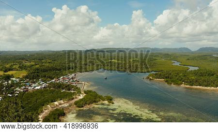 Town In Wetlands And Mangroves On The Ocean Coastline From Above. Siargao Island, Philippines.