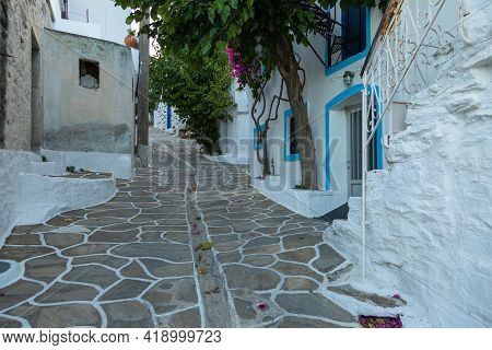 Narrow Street Of The Old Town. Traditional, Withe Architecture And A Stone Path With White Joints. B