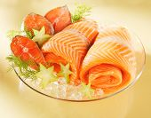 Norwegian salmon on glass plate on table poster