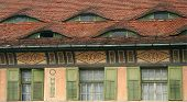 Unusual windows decor in Sighisoara town Romania poster