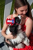 Cute patriotic spaniel dog and American girl on 4th of July poster