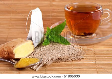 Cup of tea with ginger, honey and mint