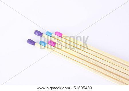 Three Color Match Sticks On White Background