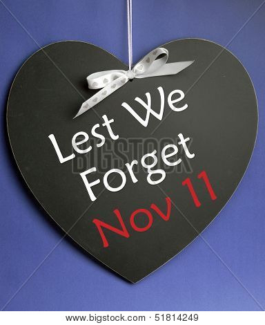 Lest We Forget Message Written On Heart Shape Blackboard For Remembrance Day, Poppy Day, Armistice D