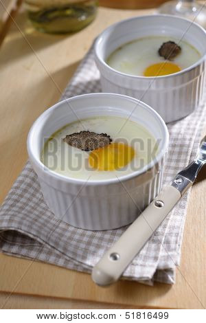 Baked egg with sliced truffle in a ramekin poster
