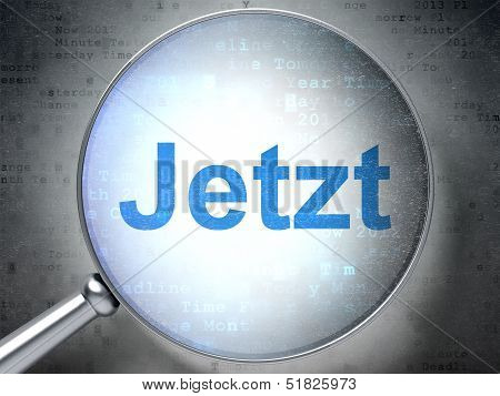 Time concept: Jetzt(german) with optical glass on digital backgr