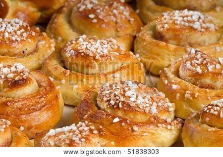 Freshly baked sweet buns or bread rolls closeup poster