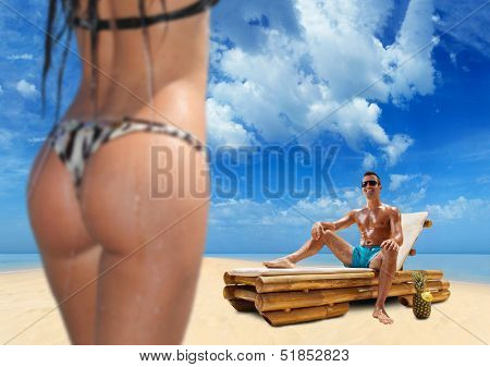 Couple on the beach Man is looking at a hot girl