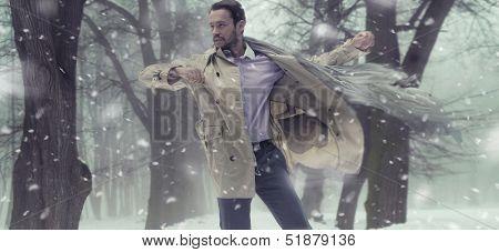 Handsome man in winter scenery