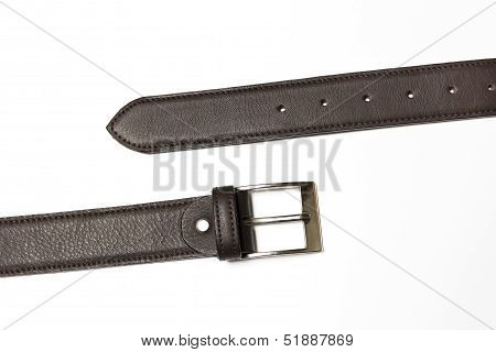 Unfastened brown leather belt