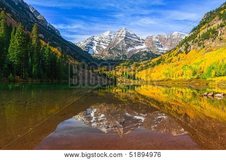 Maroon Bells and its Reflection in Maroon Lake  as Fall foliage in Peak at Aspen, Colorado
