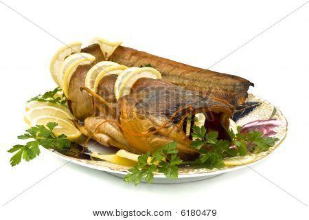 Tasty Bloated Sheatfish With Lemon And Parsley