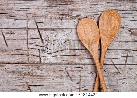 two wooden spoons on wooden background