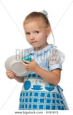 The little girl diligently washes with a sponge a plate on a white background. The mum's assistant. poster