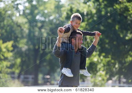 A young father enjoying a spring day with his son