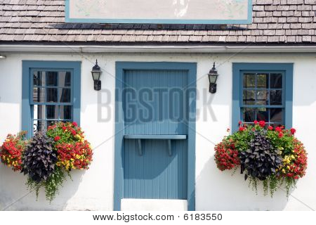 Small Colorful Cottage With Blank Sign On Roof