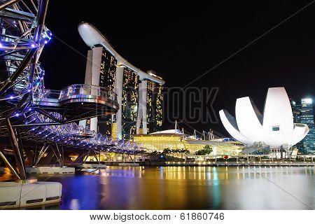 The Helix Bridge, Marina bay sands & Artscience museum at night.