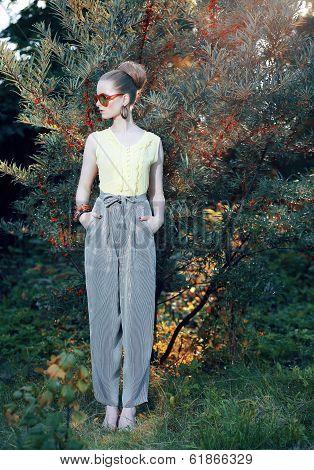Glamor. Trendy Stylish Fashion Model In Elegant Pants Outdoors