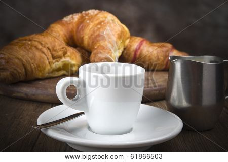 Hot coffee and fresh croissants