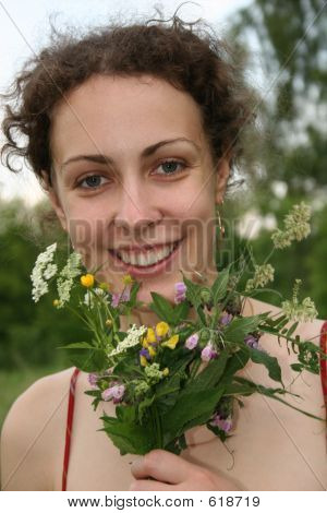 smile girl with campestral, pimpernel flowers poster