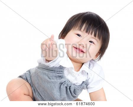 Asian baby girl finger pointing toward front