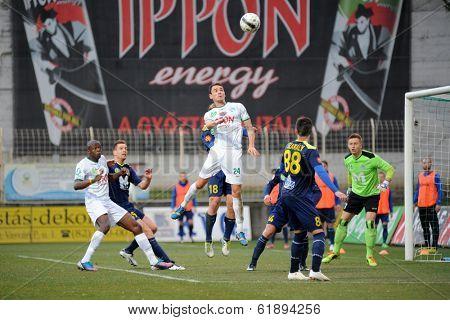 KAPOSVAR, HUNGARY - MARCH 16, 2014: Unidentified players in action at a Hungarian Championship soccer game - Kaposvar (white) vs Puskas Akademia (blue).