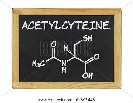 chemical formula of acetylcysteine on a blackboard