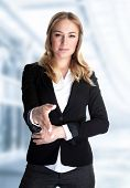Portrait of cute blond girl stretches out her hand for a handshake, work in great financial company, young business professional make a deal poster