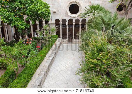 DUBROVNIK, CROATIA - MAY 26, 2014: Famous inner courtyard in the Monastery of the Friars minor in Dubrovnik, Croatia.