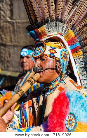 Native American Indian tribal group play music and sing on the street in historical city of York, UK