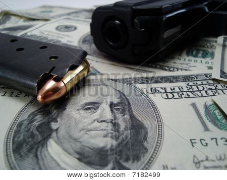 $100 Bill with Gun and Bullet