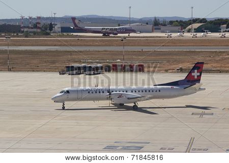 VALENCIA, SPAIN - SEPTEMBER 11, 2014: A Darwin Airline Saab 2000 aircraft taxing to the runway.  Darwin Airline is a Swiss regional airline with its head office in Agno, Switzerland.
