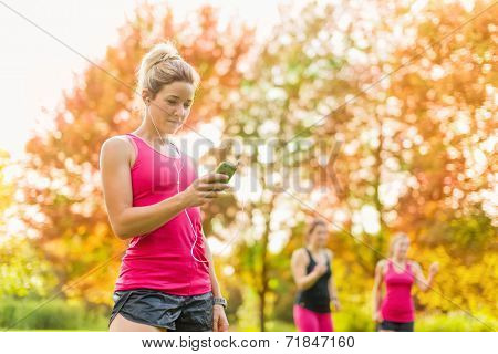 attractive woman listening to music during sport