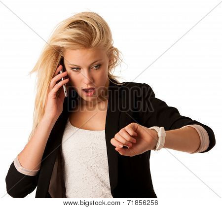 Young Blonde Woman Looks At Her Watch When She Is Being Late Isolated Over White Background