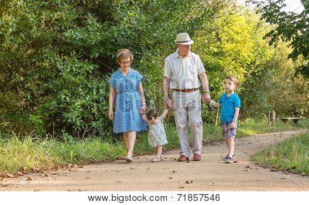 Grandparents and grandchildren walking outdoors