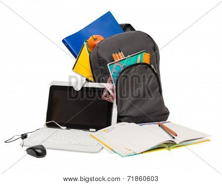 School Backpack With School Supplies And A Tablet Computer .