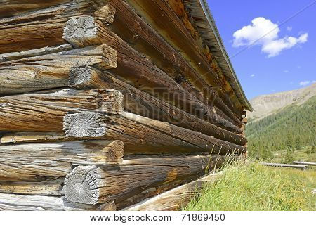 Old log cabin in abandoned mining town in western USA