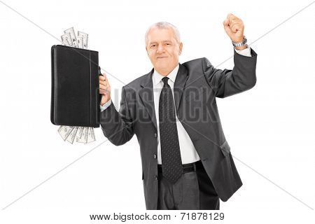 Delighted mature businessman holding briefcase full of cash isolated on white background