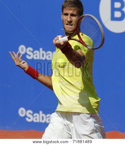 BARCELONA - APRIL, 23: Slovakian tennis player Martin Klizan in action during a match of Barcelona tennis tournament Conde de Godo on April 23, 2014 in Barcelona