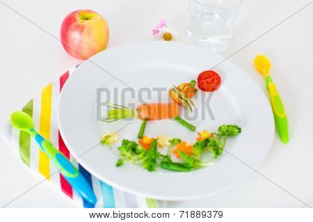 Healthy vegetarian lunch for little kids vegetables and fruit served as animals corn broccoli carrots and fresh strawberry helping children to learn eating right and clean poster
