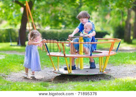 Three Kids On A Swing