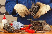 Master repairing the old car engine carburetor poster