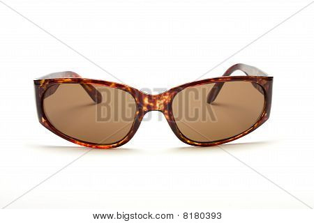 Brown Tortoise Shell Sunglasses from low perspective against white background. poster