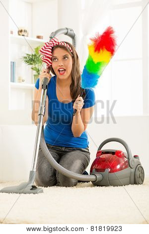 Housewife With Vacuum Cleaner And Duster